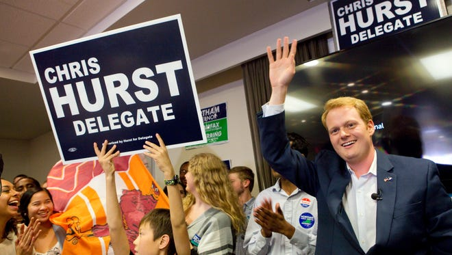 Democrat Chris Hurst defeated Republican Joseph Yost to win House of Delegates District 12 Nov. 7, 2017, in Blacksburg, Va. Hurst celebrates with a packed room of supporters at The Hyatt Place in Blacksburg.