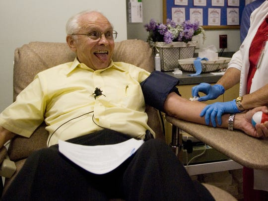 John Sheppard prepares to donate his Guinness World Records breaking 315th pint of blood at Lee Memorial Hospital in Fort Myers in 2011.