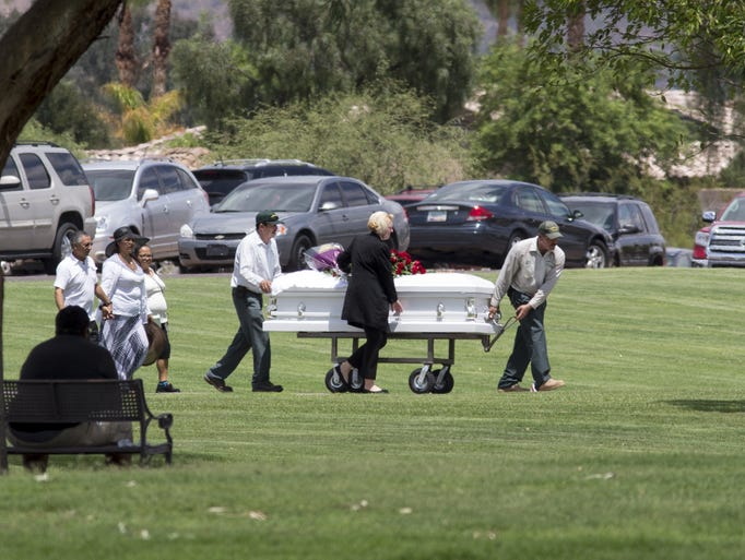 A casket is moved into place at Paradise Memorial Gardens,