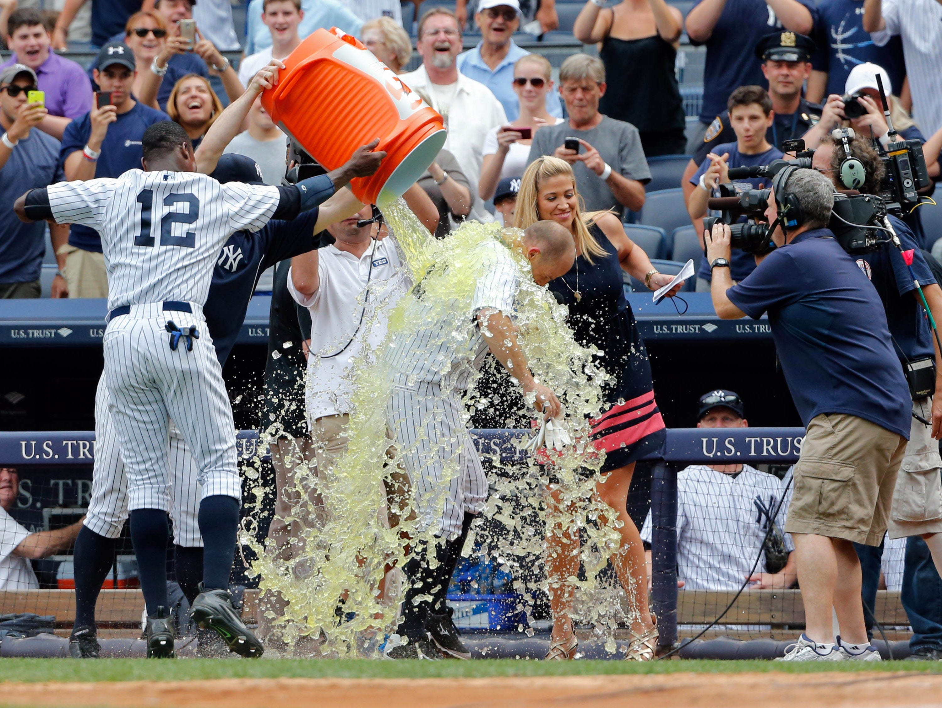 Aug. 11: Yankees center fielder Brett Gardner is dunked with Gatorade by teammates including Alfonso Soriano after hitting a walk off home run against the Tigers at Yankee Stadium.