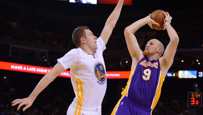 David Lee, left, and the Warriors rolled by Chris Kaman and the Lakers.