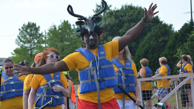 DeMarcus Horton, drummer for the Crest Industries Krakens, leads his team down the dock to a boat. The fifth annual Louisiana Dragon Boat Races were held Saturday in downtown Alexandria.