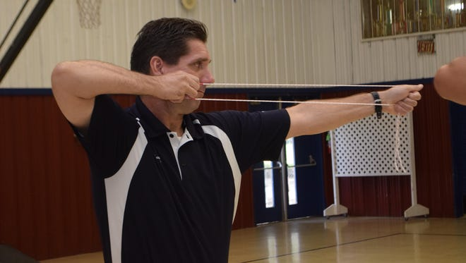 Jeff Adams, physical education teacher at Acadian Elementary School, was one of about 20 P.E. coaches learning the fundamentals of archery Thursday at St. Frances Cabrini Elementary School. Training was provided through Archery in Louisiana Schools with the Louisiana Department of Wildlife and Fisheries. The coaches can then teach the sport to their students.