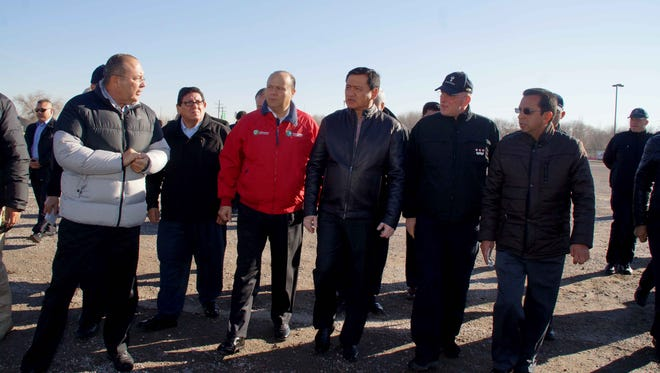 Vatican Security Chief Domenico Giani, Mexico's Secretary of the Interior Miguel Ángel Osorio Chong, Chihuahua Gov. César Duarte, Juárez Mayor Javier González Mocken and other federal, state and Juárez officials tour the old fairgrounds where Pope Francis will celebrate Mass on Feb. 17.