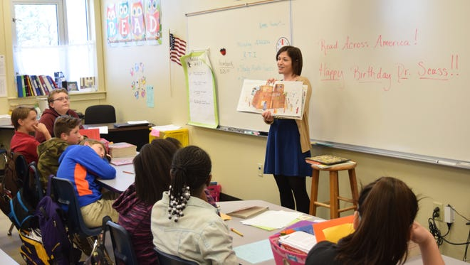 "Town Talk education reporter Leigh Guidry reads to a sixth-grade class at J.I. Barron Elementary School Wednesday. Community members were invited to read books to classes as part of ""Read Across America"" on Dr. Seuss' birthday."