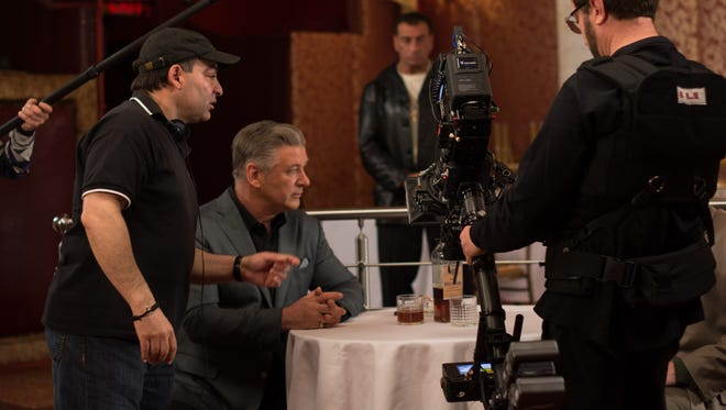 """Borghese (left) directs Alec Baldwin in a scene from """"Back in the Day."""" """"Paul impressed me with his insights and his style and I enjoyed working with him enormously,"""" Baldwin said of working with Borghese."""