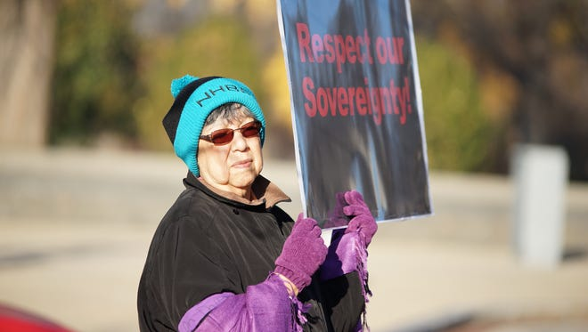 NHBP tribal member Gwynn Nugent protests at the Quilt Walk for Justice in  December 2015 in Washington, D.C.