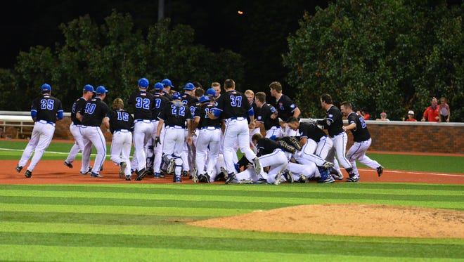 Louisiana Tech dog piles in right field following Chase Lunceford's game-winning hit Friday to beat Rice in the 15th innings.