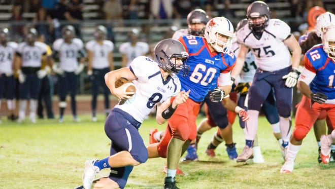 Cactus Shadows receiver Dylan Speirs runs the ball against Moon Valley on Friday, Sept. 23, 2016.
