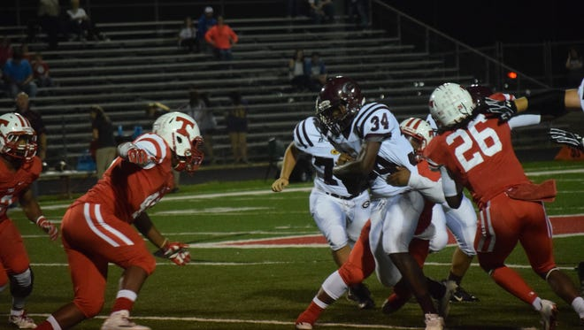 Grant running back Deante Lacour (34) looks for running room against Tioga last season.