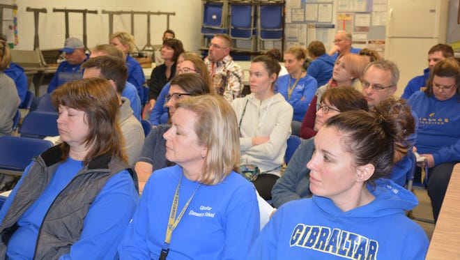 The crowd listens to members of the audience during the public comment period at the Gibraltar School Board meeting Monday, Feb. 13, 2017.