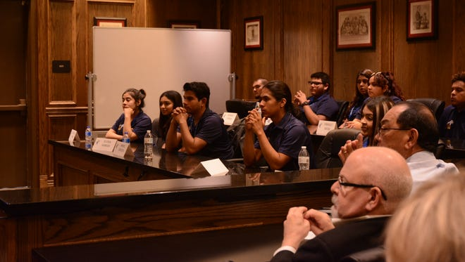 Amistad High School students listen to a presentation while sitting in a mock jury box at the California Desert Trial Academy of Law in Indio.