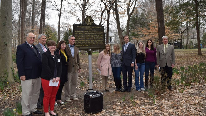 Left side of sign: Back row: Oldham County Judge Executive David Voegle; David Dick, grandson of Hattie Cochran Dick Front Row: Amanda L. Higgins, Ph.D., Community Engagement Administrator, Kentucky Historical Society; Harriet Cochran Treitz, granddaughter of Hattie Cochran Dick; George Dick, grandson of Hattie Cochran Dick. Right side of sign: Donna Russell, Pewee Valley Historian; June and Chris Kramer, current owners of the Beeches, with two of their four children, daughters  Erin (blonde) and Allison (dark hair) (not shown, their twin sons Andrew and Holden); and Pewee Valley Mayor Bob Rogers