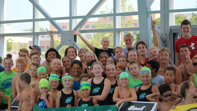 Members of t he Mountain Home Hurricanes swim team are show during the team walkout at Saturday's Southwind Conference Meet in Batesville.