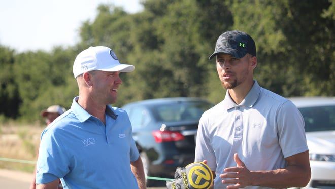 Pensacola native and Web.com Tour pro Nick Rousey, left, talks with Golden State Warriors guard and two-time NBA MVP Steph Curry before the Ellie Mae Classic in Heyward, Calif.