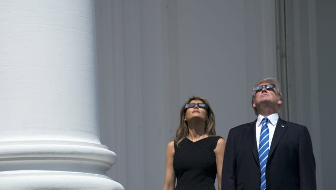 The Trumps view the solar eclipse from the Truman Balcony of the White House on Aug. 21, 2017.