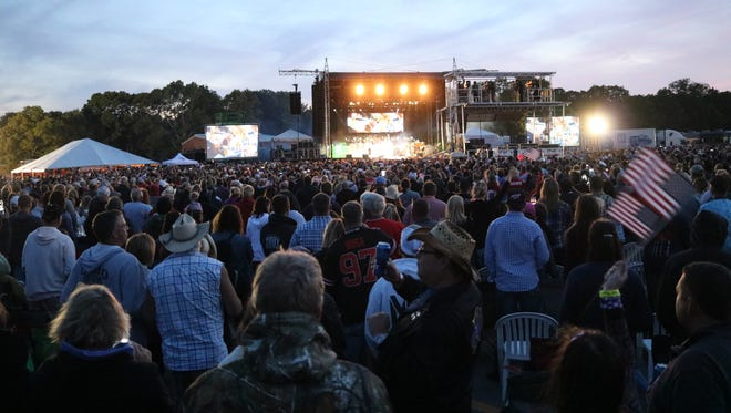 An estimated 12,000 country music fans packed the Put-in-Bay Airport to party with Toby Keith at the first-ever 'Bash on the Bay' festival, Thursday, August 31, 2017.