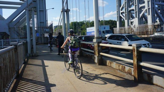 New York-bound riders on the George Washington Bridge bike path.