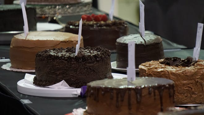 Statesman Journal columnist Capi Lynn's cake, center in the front row, is among 44 entered in the 58th annual Gerry Frank Chocolate Layer Cake Contest on Sunday, Sept. 3, 2017, at the Oregon State Fair in Salem.