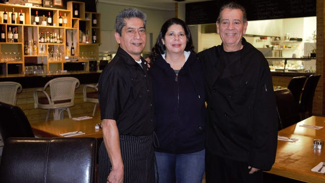 From left, George Alva, Marlene Alva and Edward Cardenas pride themselves on creating home-style Puerto Rican food at their Latin Flavor restaurant in Melbourne.