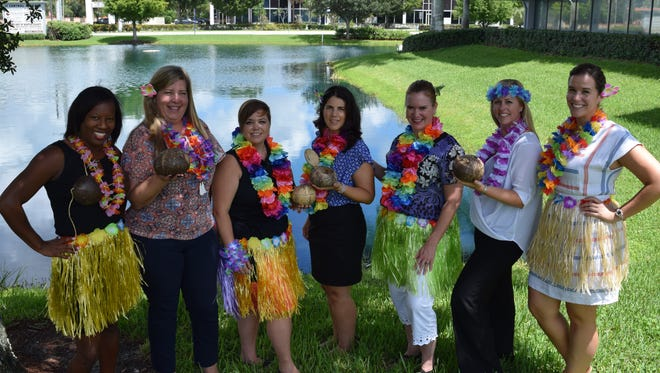 Tikis on the Terrace planning committee, from left, Natalie Desmangles, Amy Bottegal, Rachel Terlizzi, Nancy McCarthy, Donna DeMarchi, Elisabeth Glynn and Maggie Henson.