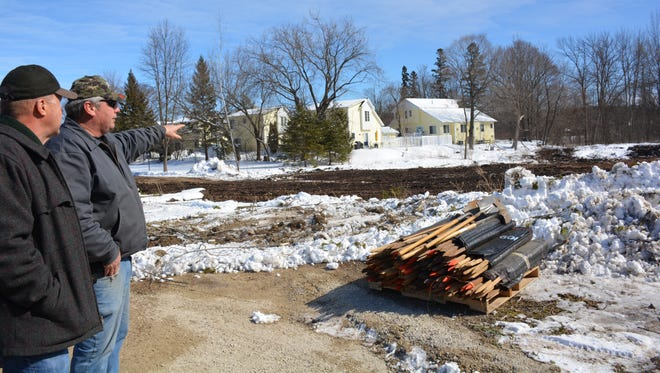 Town of Gibraltar Chairman Dick Skare, left, and Rob Robison, a construction supervisor with Door County Highway Department , discuss ideas for a bern to shield homes near location for new retention pond Friday, March 9, 2018.