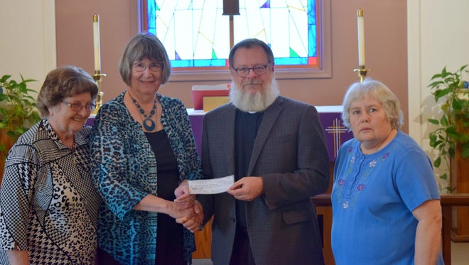 During a visit to Christ by the Lake Lutheran Church in Bull Shoals, the Rev. Michael Girlinghouse, Arkansas-Oklahoma Synod bishop, presented the Soup Sister Ministry with a $2,500 grant from the Synod's Mission Endowment Fund. The grant will fund a pilot program of homemade soup delivery to surrounding communities to those who may lack transportation. Pictured are: (from left) Soup Sisters Mary Phillips and Linda Masters, Girlinghouse and Soup Sister Sherri Mosier.