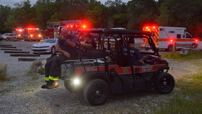 Firefighters at Ijams Nature Center prepare to transport gear to help rescue a woman on May 7, 2018.
