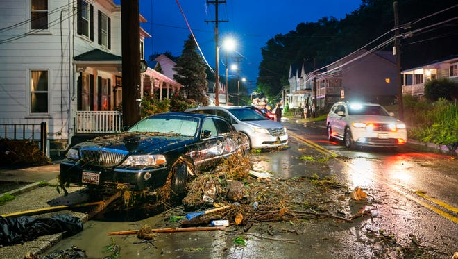 Damage cars displaced by floodwaters along Main Street in Ellicott City, Md., on May 27, 2018.