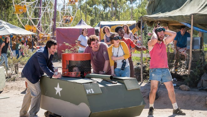 "Johnny Knoxville (left) and friends set in motion a definitely dangerous amusement-park attraction in the comedy ""Action Point."""
