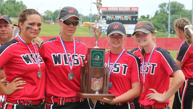 Lakota West players pose with the Division I state runner-up trophy at Firestone Stadium in Akron Saturday June 2, 2018.