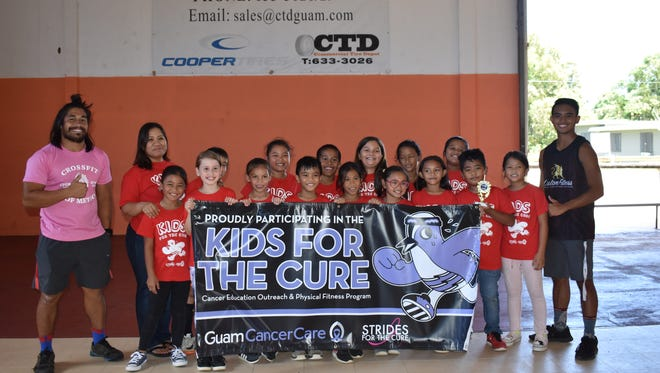 """Guam Cancer Care concluded their """"Kids for the Cure"""" program at Agana Heights Elementary School with over 200 student participants. Awards were presented to the top three classes in each grade level during the school challenge day event. Pictured: Ms. Quitugua and her third-grade class, Kids for the Cure coaches and Guam Cancer Care staff."""