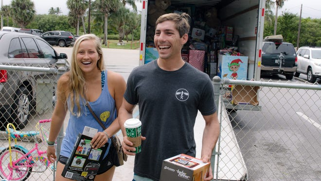 Sierra Groth and Billy Swezey, who are back in town for the winter, stopped by to say hello to old friends and drop off toys.  They make Kiting for Kids an annual event in their travels.