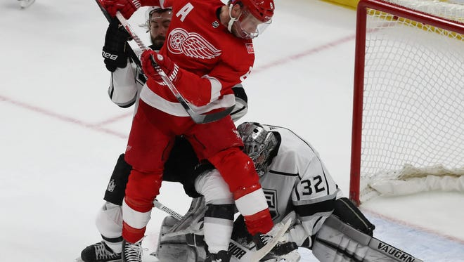Red Wings forward Justin Ablelkader takes a shot against Kings goalie Jonathan Quick during the second period of the Red Wings' 4-1 loss to the Kings on Tuesday, Nov. 28, 2017, at Little Caesars Arena.