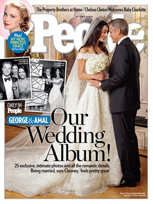 """George Clooney and Amal Alamuddin wedding on the cover of """"People"""" magazine."""