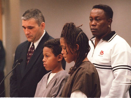 FILE PHOTO: Curtis Fairchild Jones, 12, and sister Catherine Jones, 13, making their first appearance in court with Curtis' attorney, Tony Hernandez, and their father, Curtis Jones.