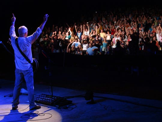 Peter Frampton has the crowd sing along with his songs during his performance at the Bowdoin Park band shell on Friday, July 28, 2006.