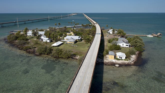 This is Seven Mile Bridge across Pigeon Key, a tiny island near Marathon, Fla., that once served as a railway laborers' base camp. We have no idea how this road was photographed without its usual crush of traffic.