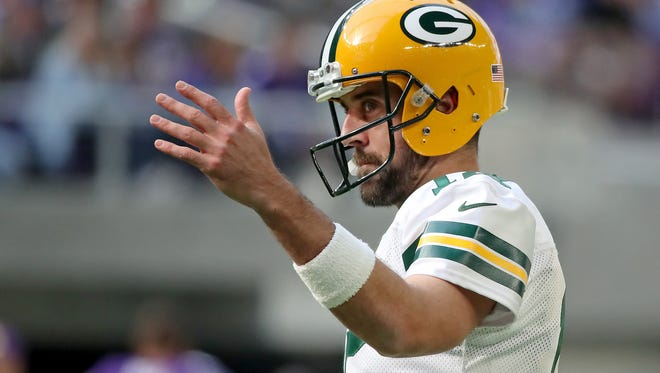 Green Bay Packers quarterback Aaron Rodgers (12) responds to fans chanting 'Go Pack Go' against the Minnesota Vikings Sunday, October 15, 2017 in Minneapolis, Minn.