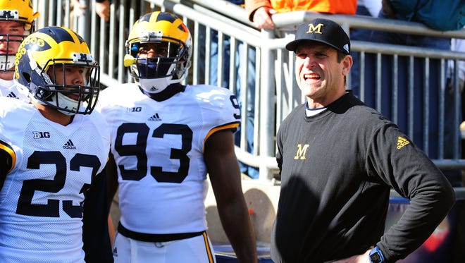 Michigan coach Jim Harbaugh looks on prior to the game against Penn State at Beaver Stadium on Saturday.