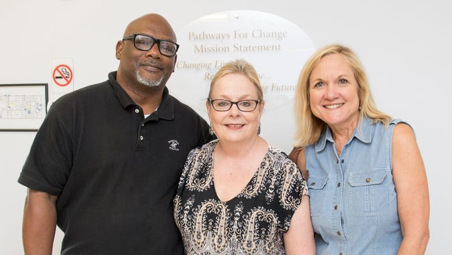 From left, Doug Brown, executive director of Community Action Program Committee, Melissa Moss, deputy director of The Florida Bar Foundation's Strategic Initiatives, and Connie Bookman, Pathways for Change CEO, stand for a photo during The Escambia Project's One Stop Life Shop event at Pathways for Change Family Center in Pensacola on Friday, Sept. 15, 2017.