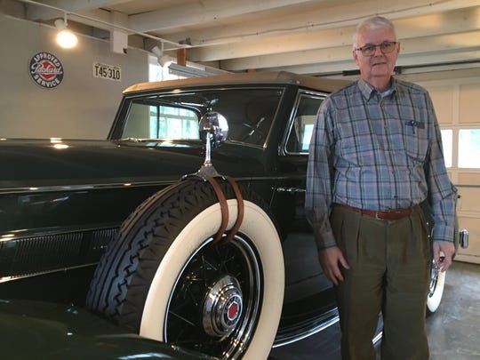 Roller Shipplett, of Staunton, stands in front of his 1935 Packard on Friday, Dec. 8, 2017.