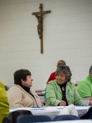 Ruth Christian, left, and Carolyn Becker, both of Henderson, sit and talk before dinner during the Holy Name Feast Day at Holy Name of Jesus Catholic School in Henderson,  Saturday, Jan. 7, 2017. The annual feast commemorates the naming of Jesus Christ.