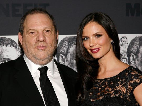 In this Dec. 3, 2012 file photo, producer Harvey Weinstein and his wife, fashion designer Georgina Chapman attend the Museum of Modern Art Film Benefit Tribute to Quentin Tarantino in New York.