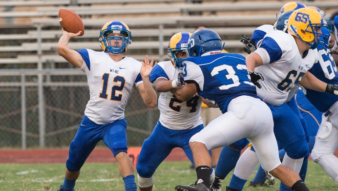 WiHi quarterback Jason Patterson (12) makes a passing play during a game against Decatur on Friday.