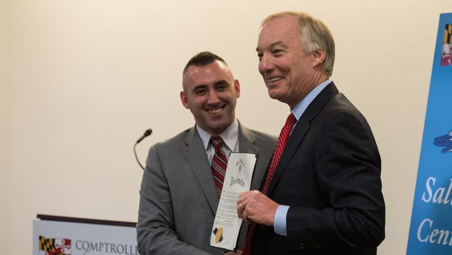 Salisbury Mayor Jake Day, left, presents Maryland Comptroller Peter Franchot a city proclamation, declaring Jan. 23 Peter Franchot day.