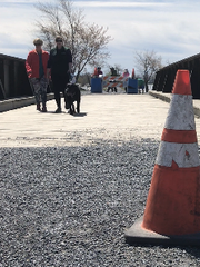 Donna Perreault, left, of New London, N.H., walks along the Colchester Causeway bridge with her daughter, Casey Rankins and dog Tucker on Saturday, May 12, 2018.