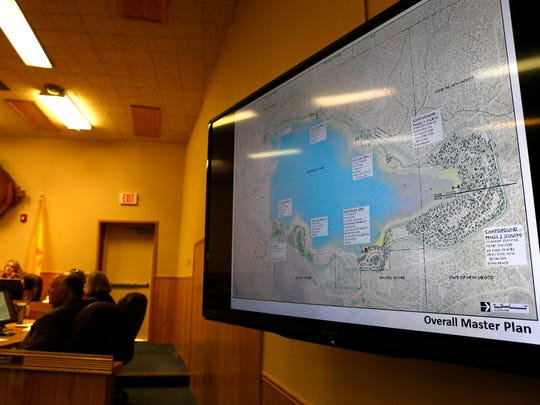 A map of Farmington Lake is displayed on monitors Tuesday during a City Council meeting.