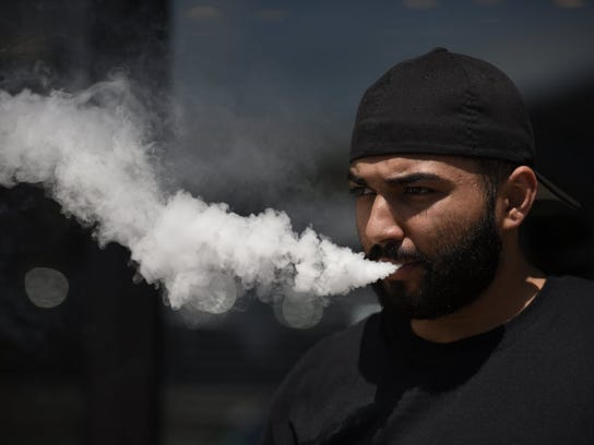 Basit Memon, shown in 2016, owns Aladdin Glass & Vape in Lodi and has said e-cigarettes have helped many of his customers quit smoking.