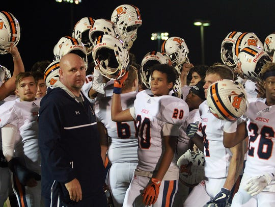 Beech raises their helmets after their win over Summit